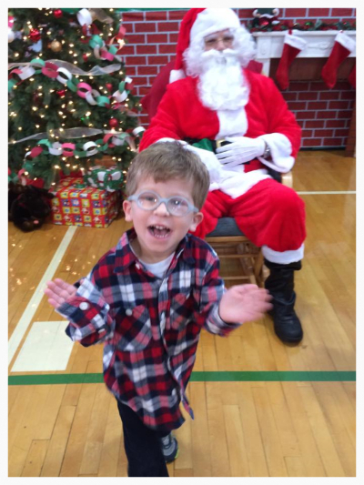 Young boy with Koolen-de Vries Syndrome happy and excited to see Santa