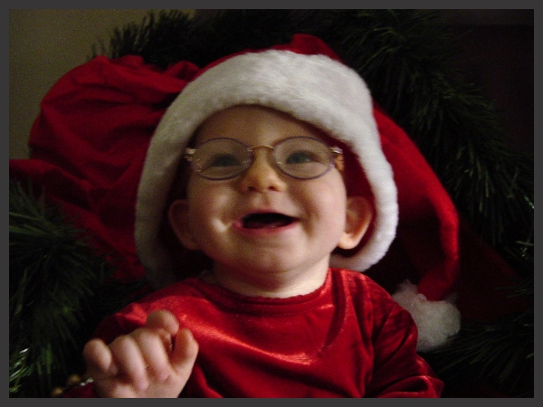 Ella young girl with glasses and a santa hat diagnosed with Koolen-de Vries Syndrome
