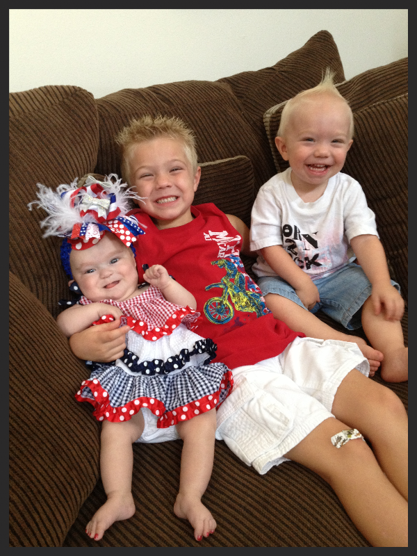 Baby girl with Koolen-de Vries Syndrome and her two brothers all in patriotic 4th of July clothing