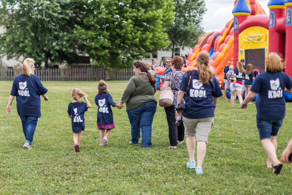Koolen-de Vries Syndrome families walking to bounce houses