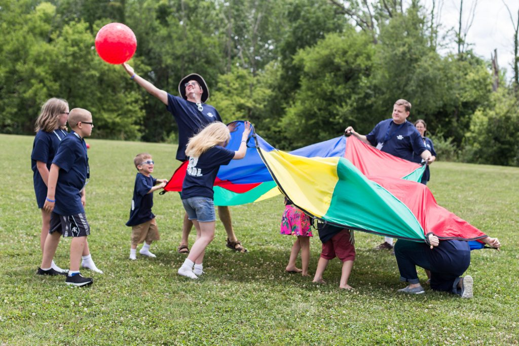 KdVS friends and family playing with a parachute and ball
