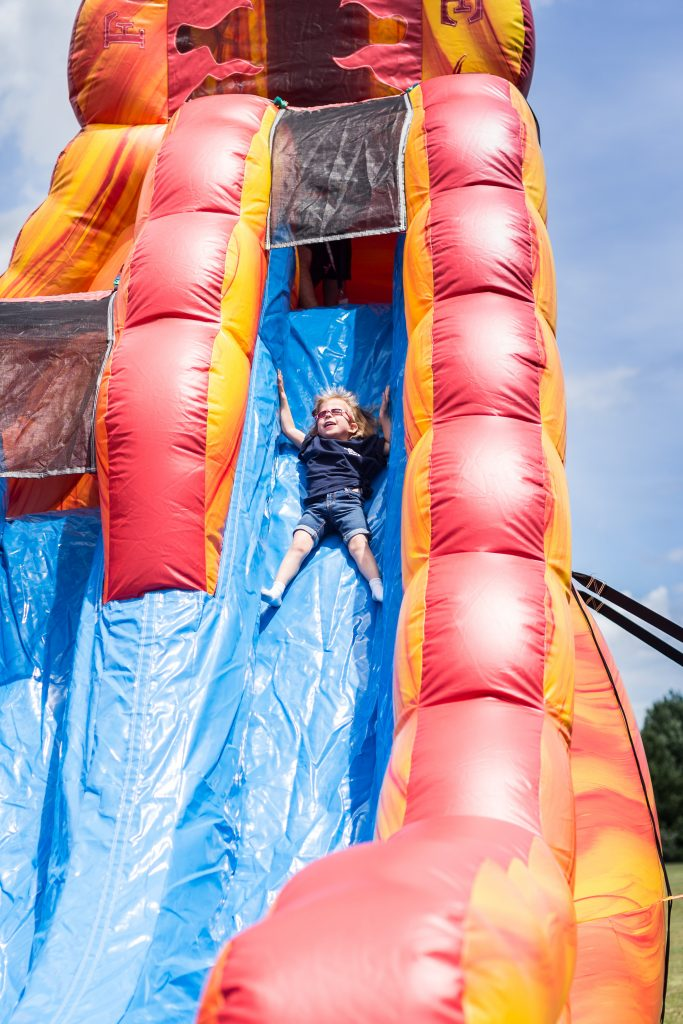 Girl with Koolen-de Vries Syndrome on bouncey slide
